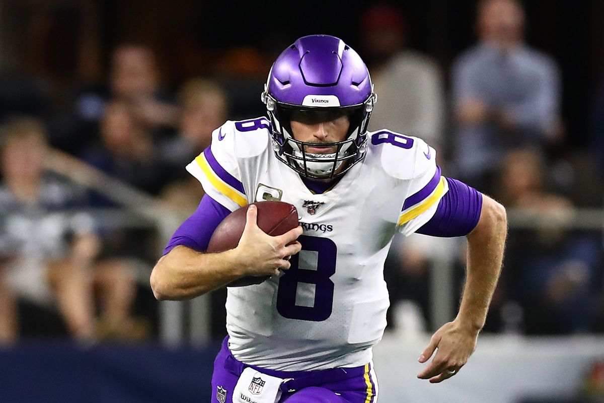 Minnesota Vikings quarterback Kirk Cousins runs with the ball in the fourth quarter against the Dallas Cowboys at AT&T Stadium.