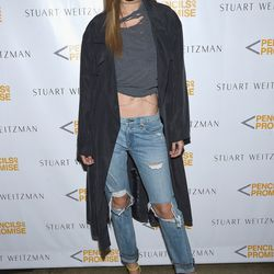 Gigi Hadid wore not only ripped denim, but also a ripped t-shirt.