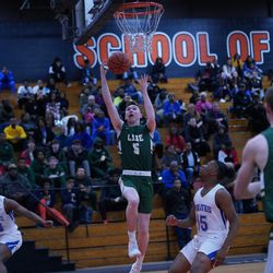 Lane's Johnny Colombo (5) gets an easy basket against Proviso East, Wednesday 02-27-19. Worsom Robinson/For Sun-Times