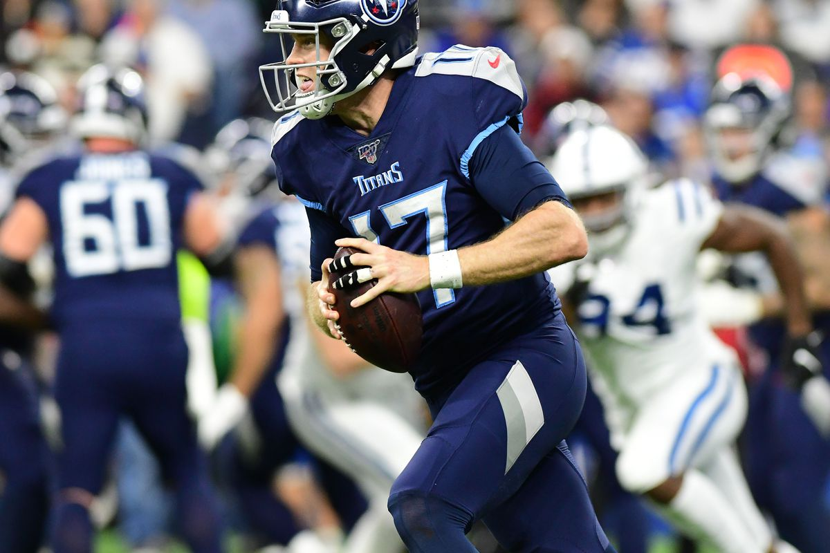 Tennessee Titans quarterback Ryan Tannehill rolls out of the pocket in the second half against the Indianapolis Colts at Lucas Oil Stadium.