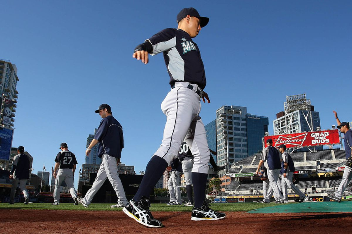 June 23, 2012; San Diego, CA, USA; Seattle Mariners shortstop Munenori Kawasaki (61) stretches before a game against the San Diego Padres at PETCO Park. Mandatory Credit: Jake Roth-US PRESSWIRE