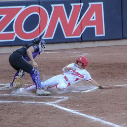 Carli Campbell slides into home