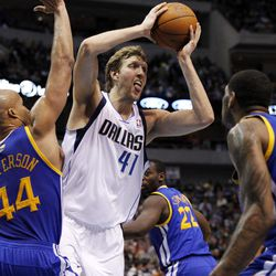 Dallas Mavericks' Dirk Nowitzki (41), of Germany, looks to pass as Golden State Warriors' Richard Jefferson (44) and Jeremy Tyler (3) defend in the first half of an NBA basketball game Friday, April 20, 2012, in Dallas.