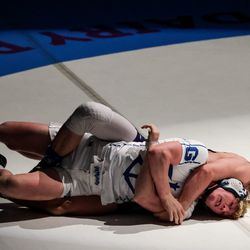 Pleasant Grove's Alex Emmer, back, defeats Koda DeAtley, also of Pleasant Grove, in the 138-pound finals match at the 6A wrestling state championship at Corner Canyon High School in Draper on Friday, Feb. 19, 2021.