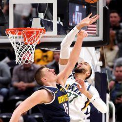 Denver Nuggets center Nikola Jokic (15) and Utah Jazz center Rudy Gobert (27) battle for the ball as the Utah Jazz and the Denver Nuggets play an NBA basketball game at VivintArena in Salt Lake City on Wednesday, Feb. 5, 2020. Denver won 98-95, giving the Jazz their fifth straight loss.