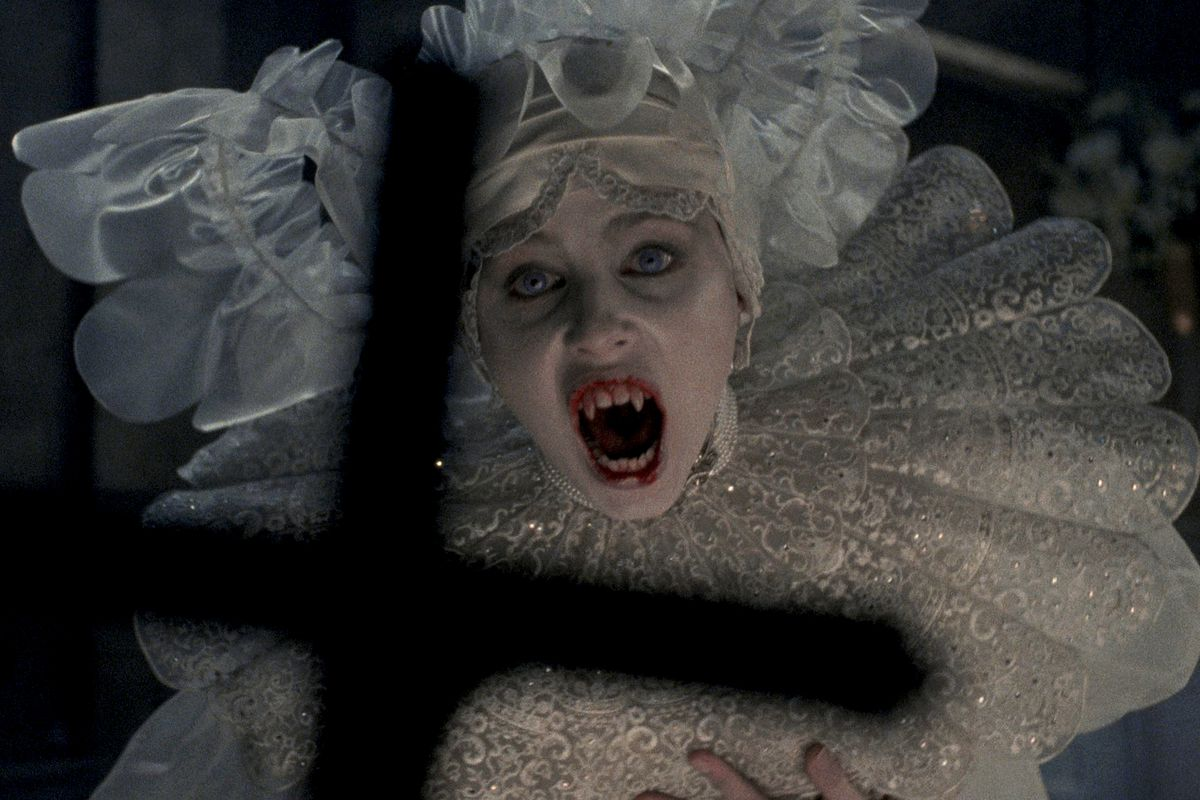 Bram Stoker's Dracula: A lady vampire in front of a cross