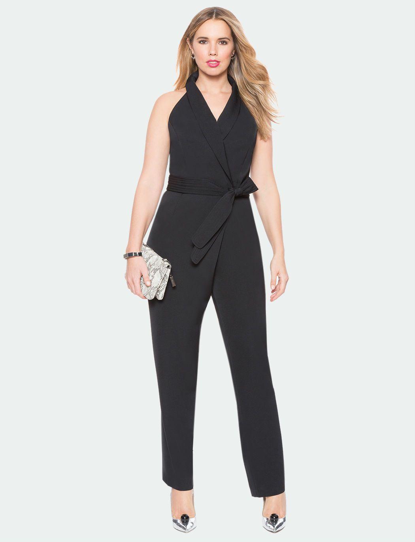 A model in a black tuxedo jumpsuit