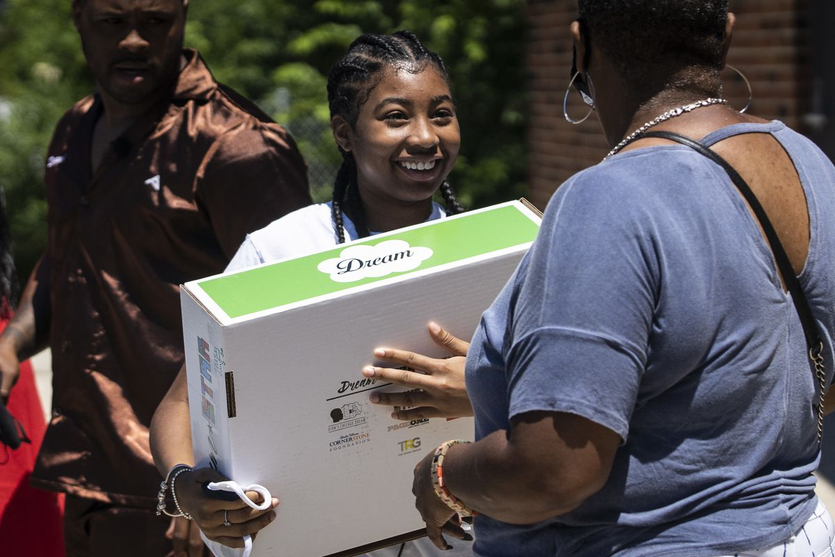 Teasia Sanford smiles as she receives a Dream Star Capsule from Dion's Chicago Dream on Monday, which presented the capsules to the 2021 8th-grade graduates at Jensen Miller Scholastic Academy at 3030 W. Harrison St. on the West Side.