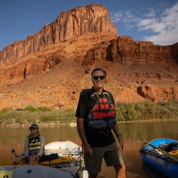 Sen. Mitt Romney, R-Utah, prepares to raft a section of the Colorado River while his wife, Ann, gets settled in their boat outside Moab on Saturday, Sept. 18, 2021.