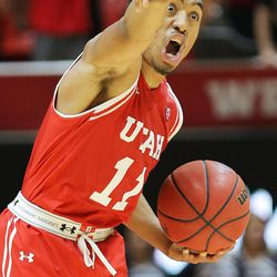 Utah Utes guard Brandon Taylor (11) yells to a teammate as Utah and BYU play in the Huntsman Center in Salt Lake City Wednesday, Dec. 2, 2015. Utah won 83-75.