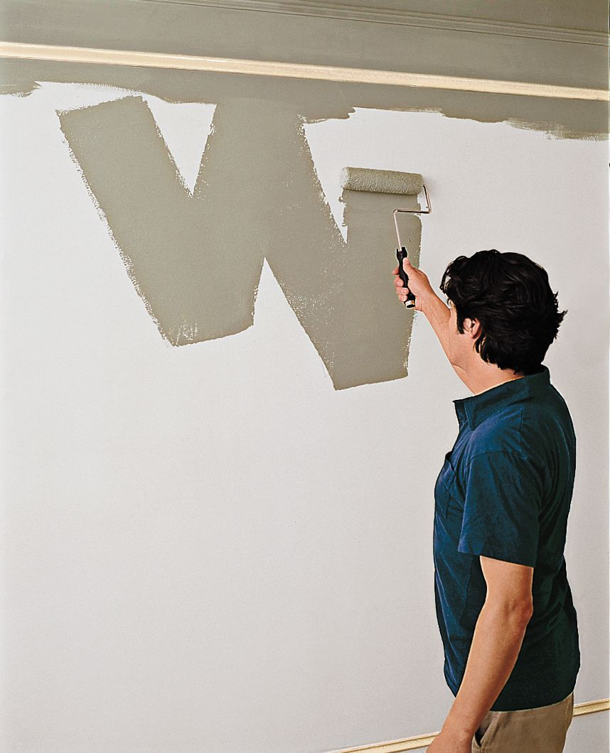Rolling a W shape on the wall with roll brush.