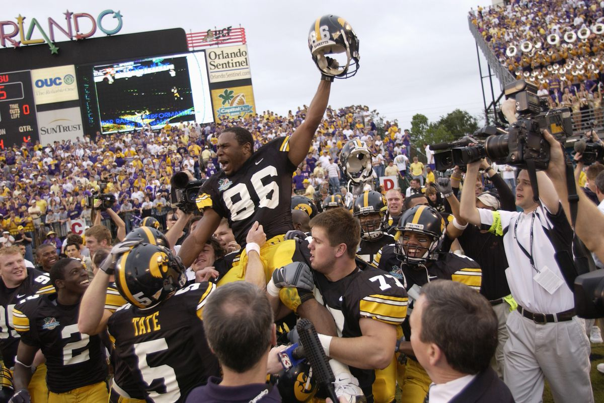 Warren Holloway #86 of the Iowa Hawkeyes is carried on the field by teammates following the Capital One Bowl