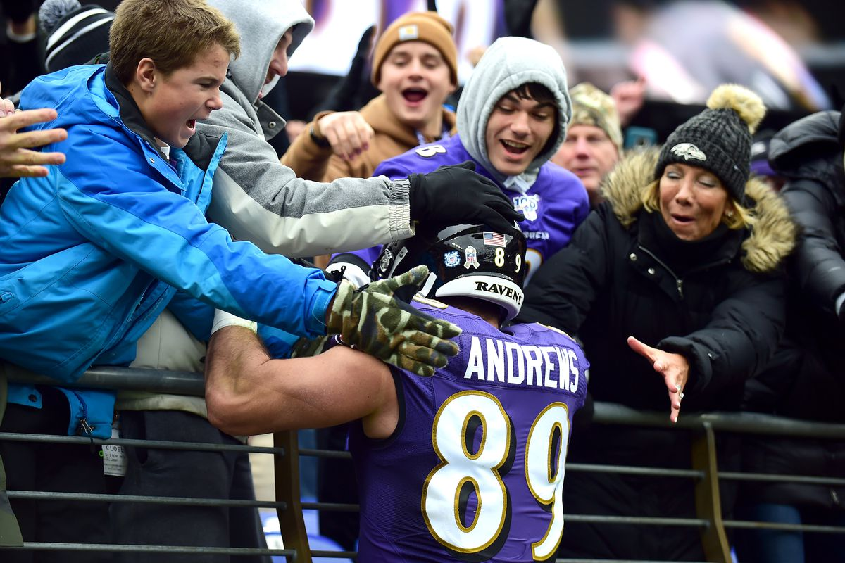 Baltimore Ravens tight end Mark Andrews celebrates with fans in the stands after scoring a touchdown in the second quarter at M&T Bank Stadium.