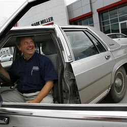 Andy Ross of Mark Miller Toyota finishes test-driving a 1989 Ford Crown Victoria brought in as a clunker by a customer from Wyoming.