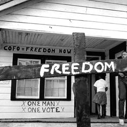 After the Ku Klux Klan burned a cross in a Mississippi Delta Freedom House, a civil rights worker painted it over with a message.