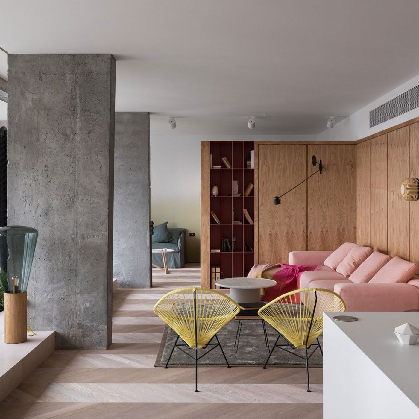Modern apartment renovation uses concrete and pink to subtle effect