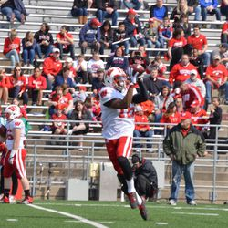 Wide receiver Reggie Love hauls in a pass.
