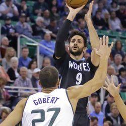 Minnesota Timberwolves guard Ricky Rubio (9) shoots as Utah Jazz center Rudy Gobert (27) defends during the first half in an NBA basketball game Friday, April 7, 2017, in Salt Lake City. (AP Photo/Rick Bowmer)