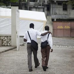 Members of the Petionville Ward; one of three wards that meet in the building, leave following meetings at the Petionville LDS Meetinghouse in Petionville, Haiti on Sunday, May, 23, 2010.
