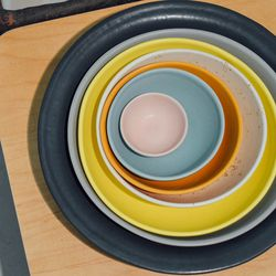 Invest in one good set of plates and bowls (or mix-and-match to build your own).