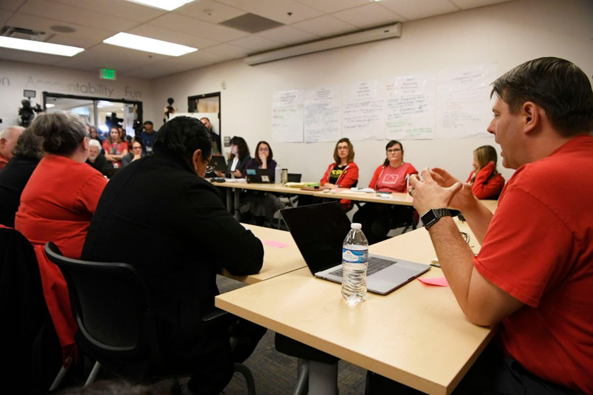 Denver Classroom Teachers Association lead negotiator Rob Gould, right, talks during a bargaining session with district administrators.