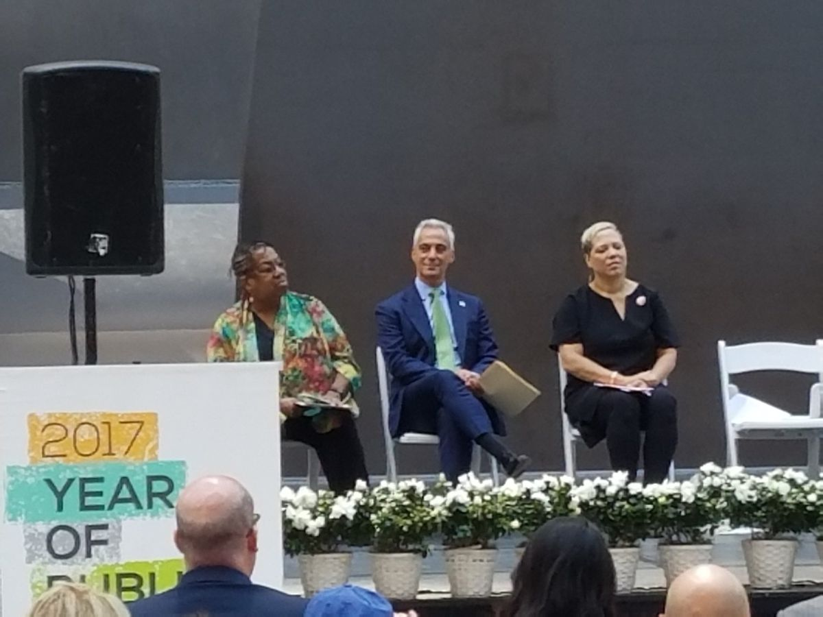Mayor Rahm Emanuel keeps an eye on a protester from the stage at the Daley Plaza ceremony marking the 50th anniversary of the Picasso sculpture. | Nader Issa/Sun-Times