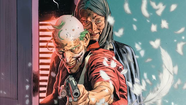 The Joker, geriatric but grinning, levels a smoking gun, surrounded by pillow feathers from the holes he just fired into the furniture. Grey haired, Catwoman stands behind him, smiling with menace, a picture frame in one hand, in Batman/Catwoman #1, DC Comics (2021).