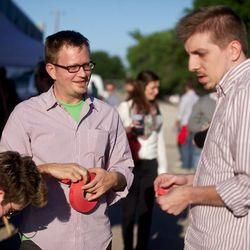 Eater National editor Raphael Brion hands out beer tickets and finds his button-down twinsie.