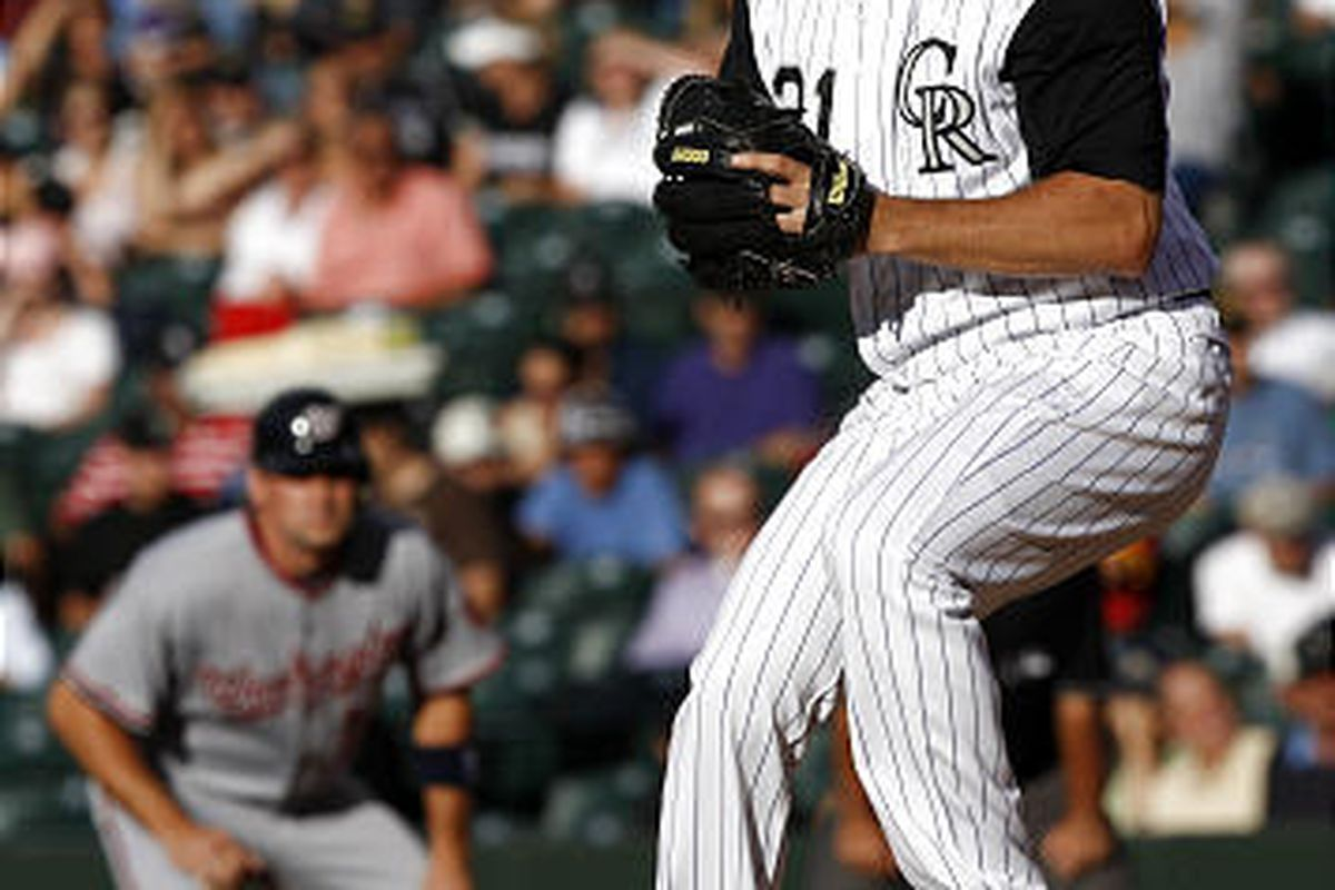 Colorado Rockies starting pitcher Jason Marquis, front, looks to throw as Washington Nationals base runner Ryan Zimmerman leads off first base in the first inning of a baseball game in Denver on Monday, July 6, 2009. (AP Photo/David Zalubowski)