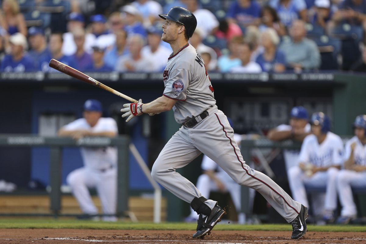 This is a picture of Justin Morneau hitting a dinger