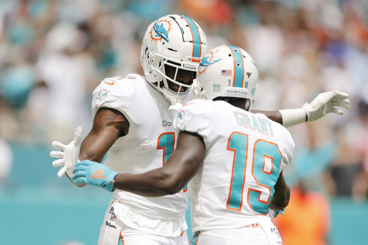 DeVante Parker #11 of the Miami Dolphins celebrates with Jakeem Grant #19 after a touchdown reception against the Los Angeles Chargers during the first quarter at Hard Rock Stadium on September 29, 2019 in Miami, Florida.