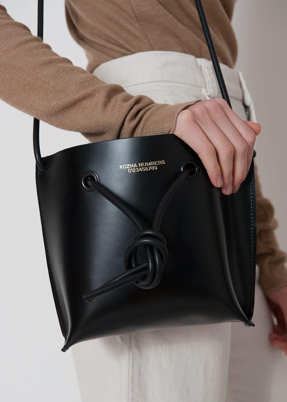 Model holding Kozha Numbers Ket Bag