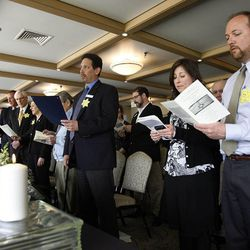 Those in attendance recite the Kaddish during a Utah Holocaust Memorial Commemoration at the Jewish Community Center in Salt Lake City, Thursday, April 19, 2012.