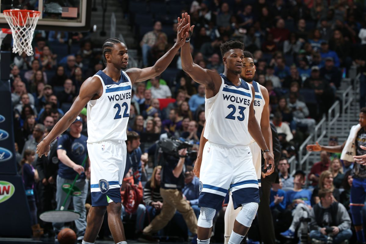 Andrew Wiggins and Jimmy Butler high-five