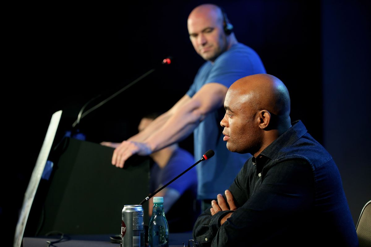 Dana White watches as Anderson Silva answers questions during a 2013 press conference.