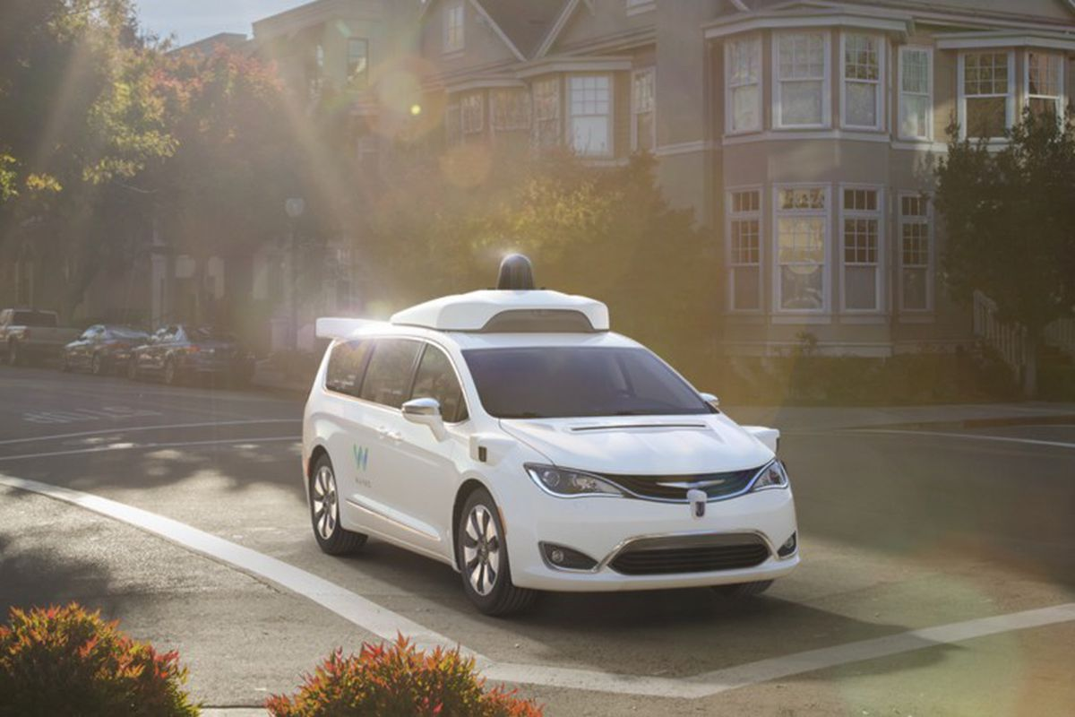 a self-driving Way car drives down a residential street