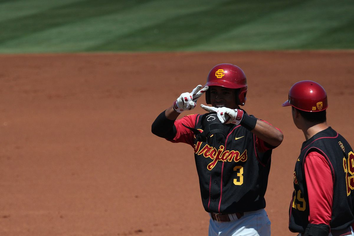 USC junior second baseman Dante Flores (left) had three hits and two RBIs in the Trojans' 8-7 win over ASU Sunday afternoon.