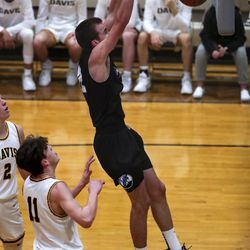 Layton's Andrew Brown throws down a dunk during a boys basketball game against Davis in Kaysville on Friday, Jan. 22, 2021.