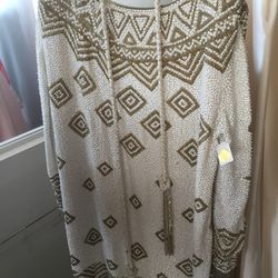 Beaded white and gold dress, $1,200