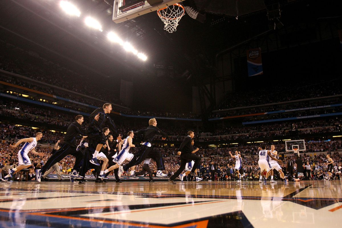 Duke rushes the court in 2010 after Gordon Hayward's three-quarter shot barely missed.