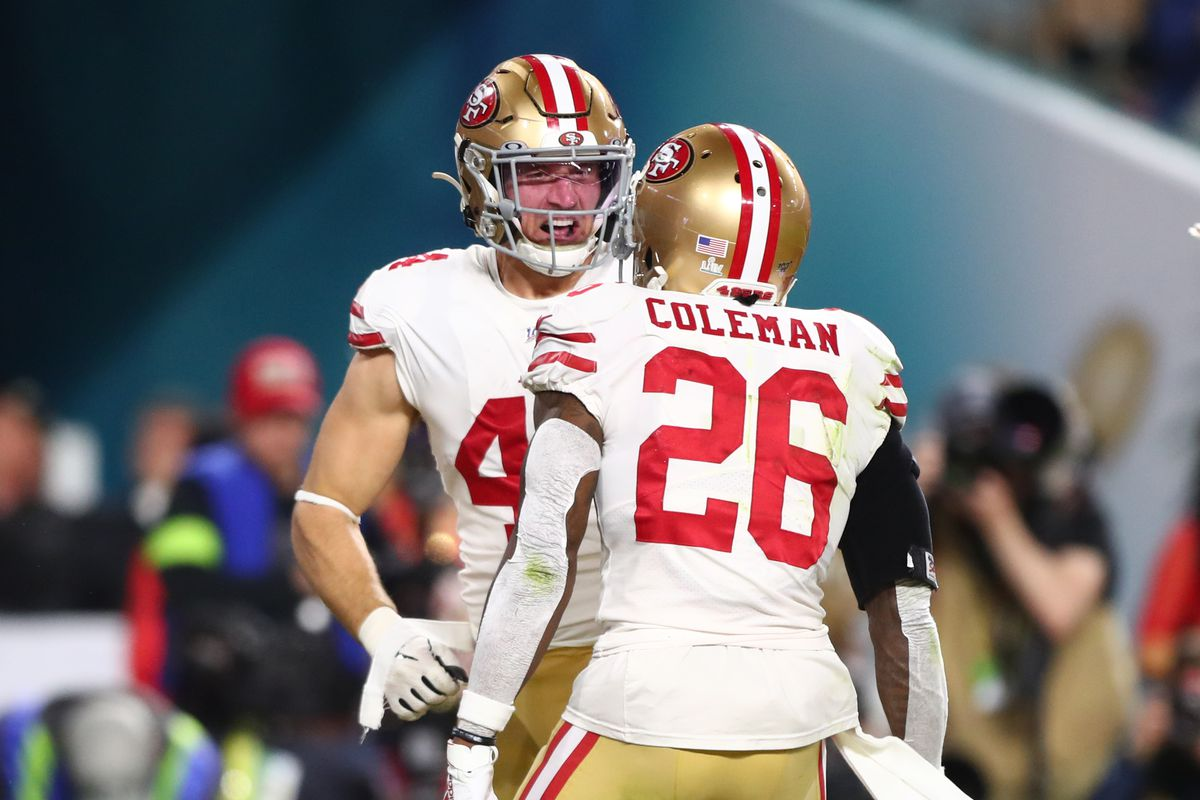 San Francisco 49ers fullback Kyle Juszczyk celebrates with running back Tevin Coleman after scoring a touchdown against the Kansas City Chiefs in the second quarter in Super Bowl LIV at Hard Rock Stadium.