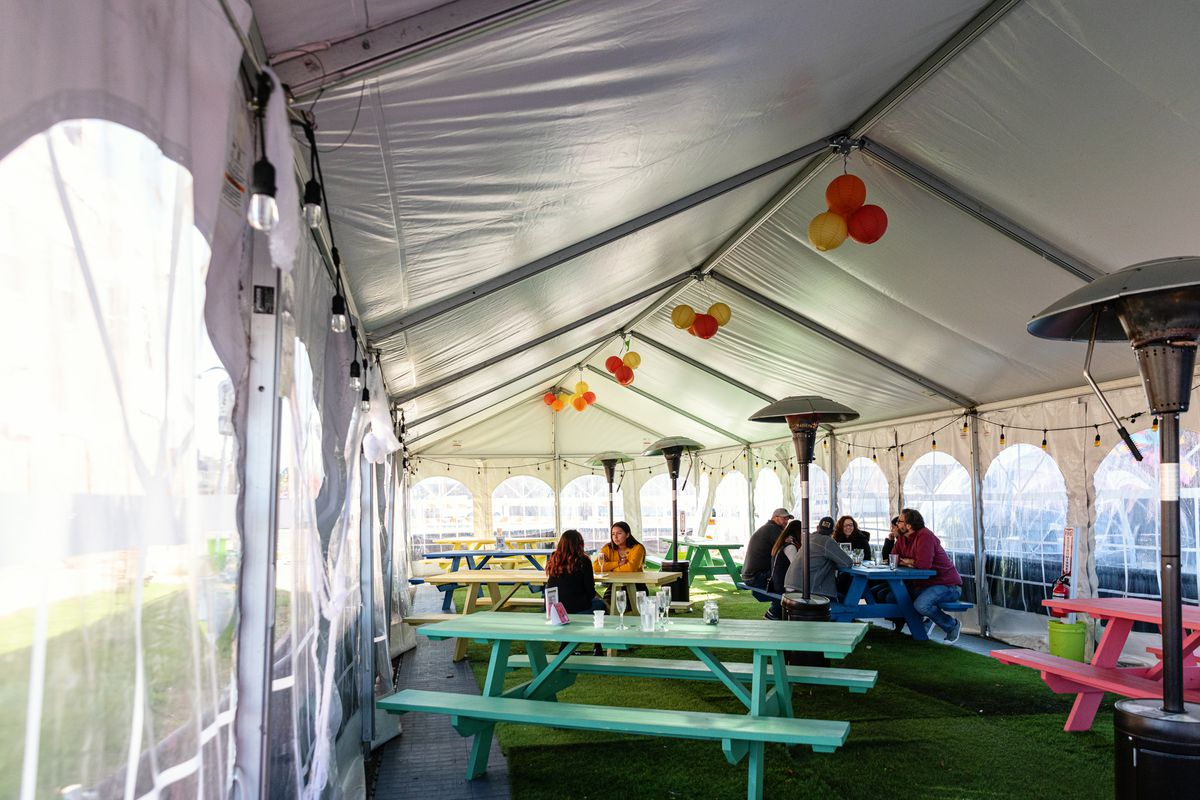 A heated indoor tent at Bobcat Bonnie's is filled with colorful picnic tables.
