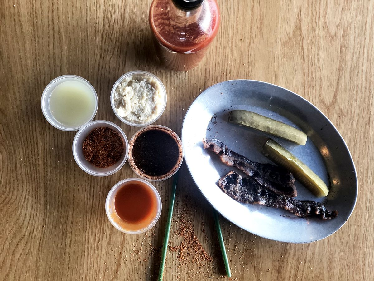 Overhead view of bloody mary ingredients on a wooden table