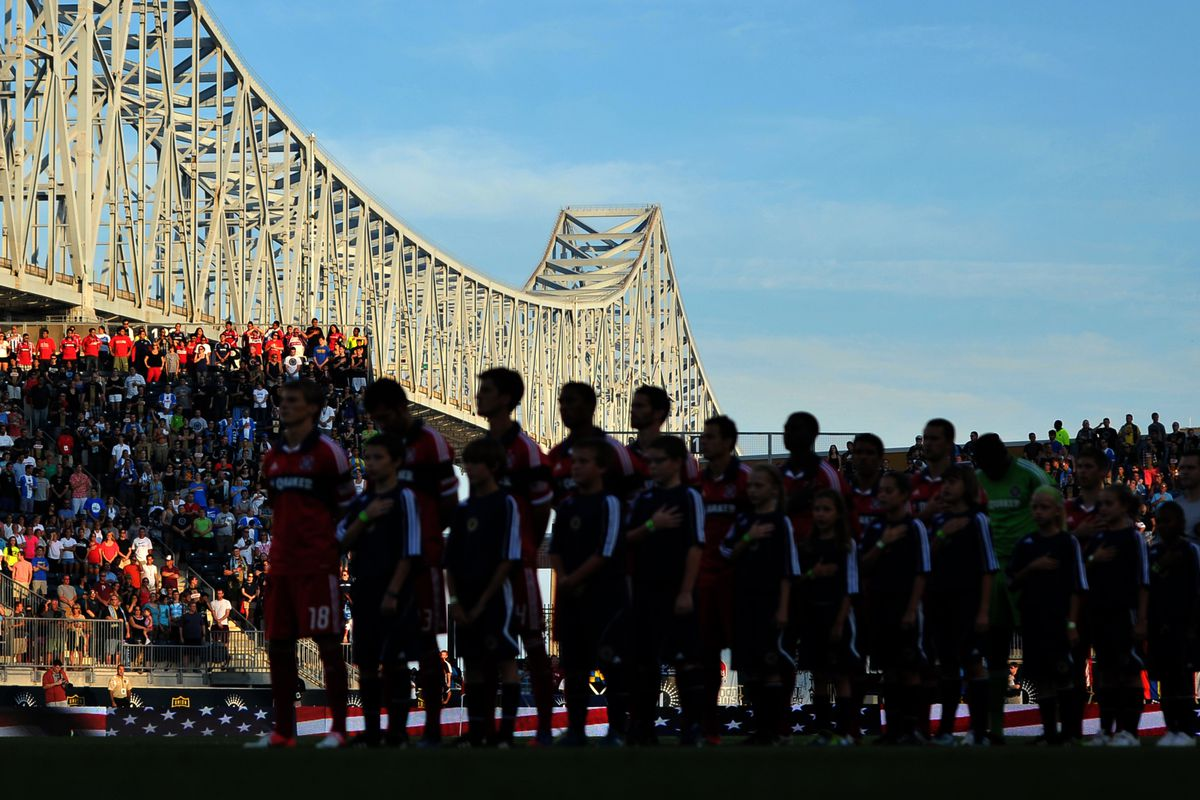 CHESTER, PA - AUGUST 12: Fans and players observe the National Anthem before the match between the Chicago Fire and Philadelphia Union at PPL Park on August 12, 2012 in Chester, Pennsylvania. The Fire won 2-1. (Photo by Drew Hallowell/Getty Images)