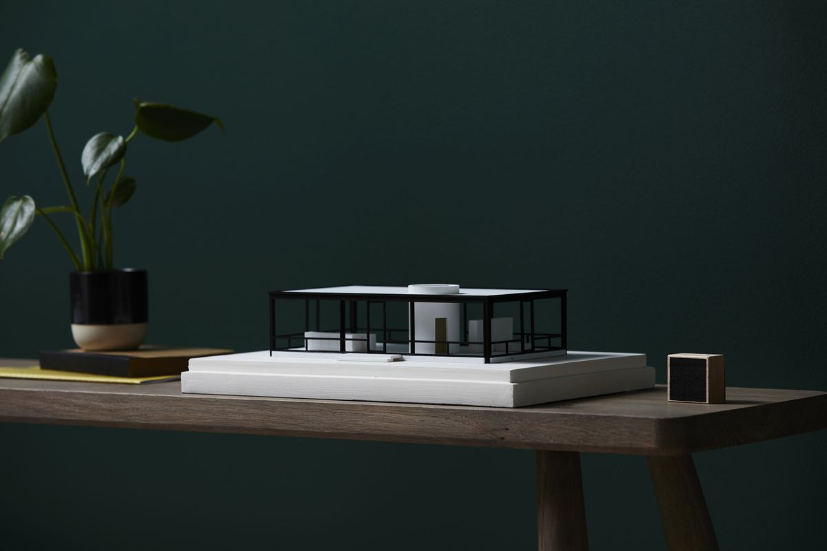 3D-printed replica of Glass House on a table.