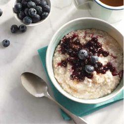 The breakfast menu includes steel cut oatmeal, coconut yogurt, chia berry tapioca, and coconut yogurt parfait ($2.50 - $6)