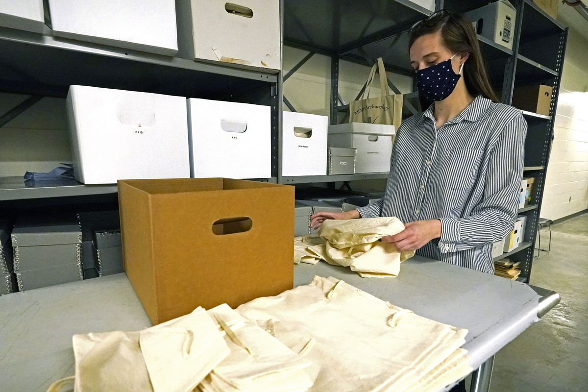 Jessica Walzer, archaeology collections manager with the Mississippi Department of Archives and History, gathers prehistoric pottery and lithics. Several hundred Chickasaw ancestors and artifacts are being returned by the state museum to native hands to be laid to their final rest.