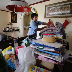 President Ricardo A. Aban of the Tacloban Philippines Stake of The Church of Jesus Christ of Latter-day Saints cleans up his home in Tacloban, Friday, Nov. 22, 2013 following a typhoon.