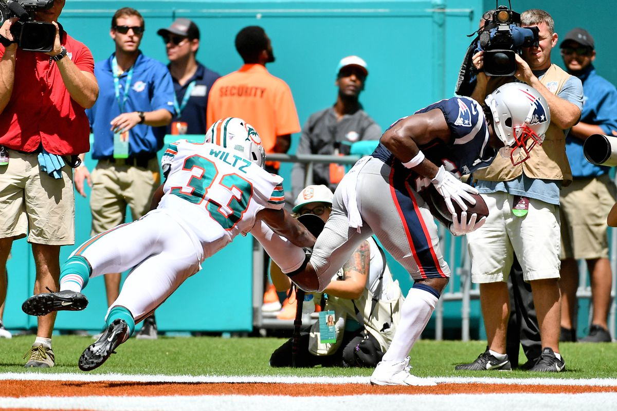 New England Patriots wide receiver Antonio Brown makes a catch for a touchdown against the Miami Dolphins during the first half at Hard Rock Stadium.