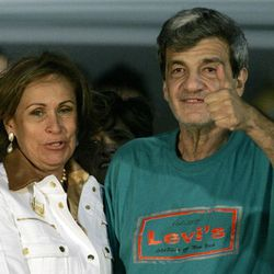 FILE - In this Feb. 27, 2008 file photo, former Colombian Senator Jorge Eduardo Gechem, right, gives a thumbs up as he stands with his wife Claudia del Carmen after being released by the Revolutionary Armed Forces of Colombia, or FARC, at the airport in Maiquetia, Venezuela.  Gechem was released in Colombia's Guaviare state. Gechem, who was kidnapped in 2002 by the FARC in a plane hijacking that triggered the end of government-rebel peace talks, said his greatest affliction since his 2008 release has been the inability to get regular sleep.